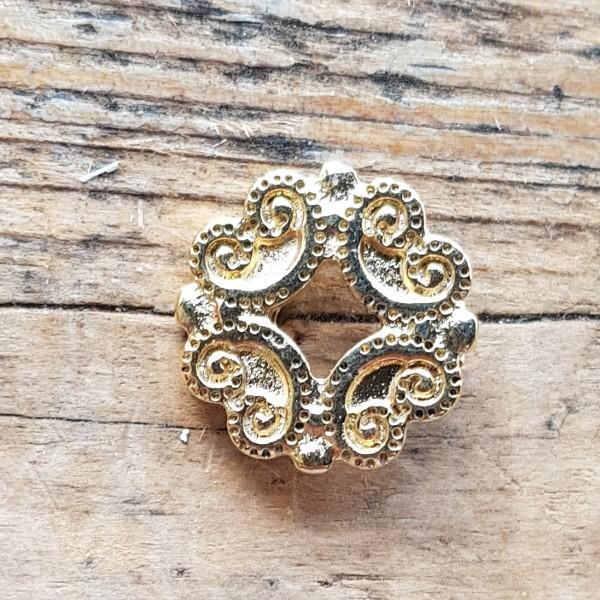 Trachten-Ornament, goldene Zierniete