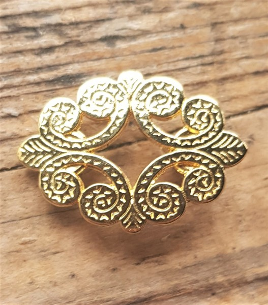 Trachten-Ornament, ovale goldene Zierniete